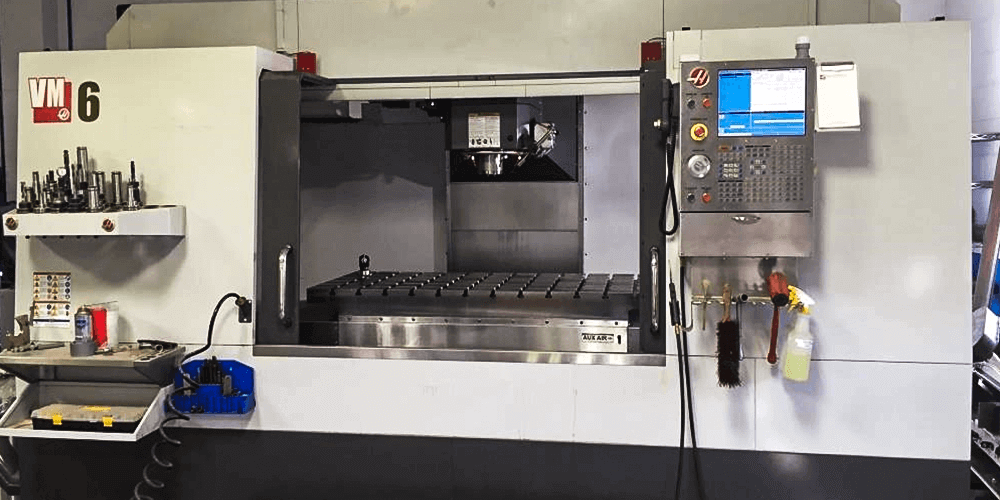 The HAAS VM6 CNC Mill at our shop in Hartford, Wisconsin